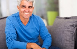 Man sitting on couch and smiling