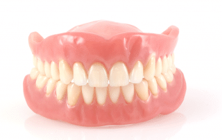 talking dentures on a table