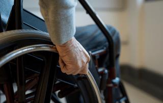 hands of man in wheelchair