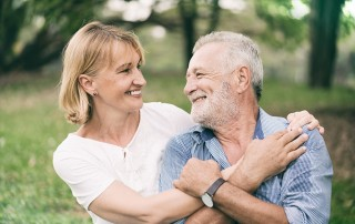 Happy older couple making their marriage last - just like their implant dentures