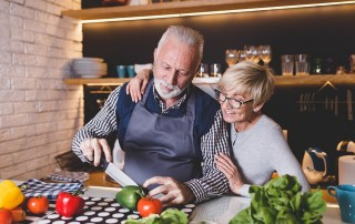 mature couple preparing dinner together