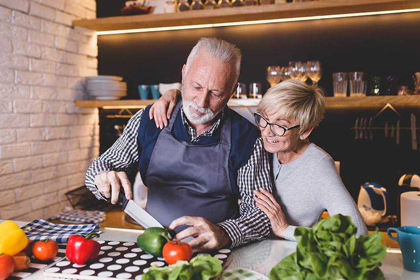 mature couple preparing dinner together