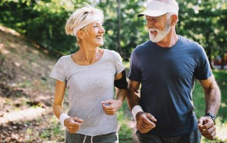 Happy senior people running to stay healthy