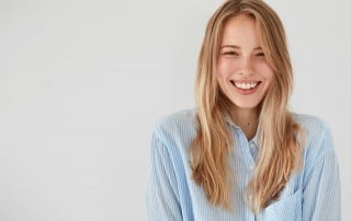 cute woman showing off her smile